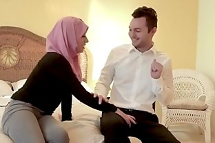 Busty chick rides fat cock in Hijab